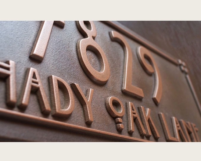 pacific style copper craftsman address plaque carved close up